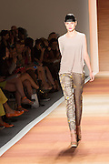Beige, gray and yellow patterned pants with  a beige sleeveless knit top.