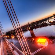 Standing on the Broadway Bridge looking east at sunrise over the Missouri River, Kansas City, Missouri.