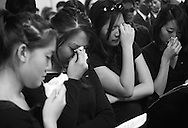 Christina Chung, Connie Chung, Elaine Kao and Gloria Pak, from left, mourn during the funeral for three young Korean kids killed in an auto accident last week while returning from a wedding. Jennifer Suh, 20, and her brother Allen, 22 and a close family friend James Pak, 16, were memorialized at the Jehovah's Witnesses Kingdom Hall in Tustin Saturday April 9, 2005.