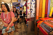 29 JUNE 2011 - CHIANG MAI, THAILAND: Shoppers on Chang Klan Street in the night bazaar in Chiang Mai, Thailand. The night bazaar is one of the Thai city's main shopping and tourist attractions.   PHOTO BY JACK KURTZ