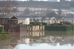 © Licensed to London News Pictures 28/12/2020. Yalding, UK. Fields around Little Venice Caravan park are flooded. Yalding village in Kent and surrounding areas are flooded due to the river Medway and river Beult bursting their banks. Photo credit:Grant Falvey/LNP