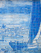 Detail of an azulejo, a glazed, ceramic tile-work, on the streets of the Alfama district, Lisbon, Portugal