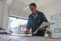 April 12, 2018 - Jinping, Guizhou, China - Zhang Linchang, a village postman walked 240 thousand kilometres and delivered 1.4 million newspapers and letters to the villagers who lives in remote mountains in 31 years in Jinping, Guizhou, China on 12 April 2018. (Credit Image: © TPG via ZUMA Press)