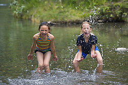 July 21, 2019 - Girls Playing In Water (Credit Image: © Carson Ganci/Design Pics via ZUMA Wire)