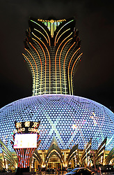Illuminated new Grand Lisboa casino and hotel at night in Macau China 2008