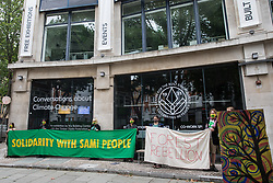 London, UK. 24th July, 2021. Activists from the Forest Rebellion protest outside the premises of the Timber Trade Federation at the Building Centre. The activists were protesting against the clearcutting of natural forests in Sweden and the social and environmental impacts of timber imports from Swedish logging companies with UK subsidiaries belonging to the Timber Trade Federation, whilst also standing in solidarity with the indigenous Sami people of northern Scandinavia.