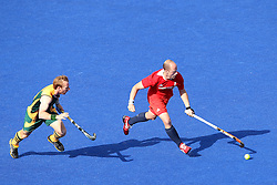 Ben Hawes of Great Britain makes the run during the men's hockey match between South Africa and Great Britain held at the Riverbank Arena at Olympic Park in London as part of the London 2012 Olympics on the 1st August 2012..Photo by Ron Gaunt/SPORTZPICS