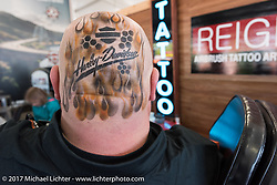 Harley-Davidson's Douglas Bear Armstrong sports an airbrush tattoo that they were offering at the Harley-Davidson display at the Daytona Speedway during Daytona Bike Week. Daytona Beach, FL. USA. Wednesday March 15, 2017. Photography ©2017 Michael Lichter.