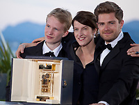 Un Certain Regard Best Performance winner Victor Polster for his role in the film Girl, Camera d'Or jury head Ursula Meier and Camera d'Or winner Director Lukas Dhont at the Award Winner's photo call at the 71st Cannes Film Festival, Saturday 19th May 2018, Cannes, France. Photo credit: Doreen Kennedy