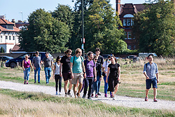 """© Licensed to London News Pictures. 13/09/2020. London, UK. Walkers enjoy the sunshine on Wimbledon Common in South West London this afternoon a day before the """"Rule of 6"""" comes into force on Monday as weather experts announce a 5 day mini-heatwave in the South East of England this week with highs of 29c. Prime Minister Boris Johnson announced on Friday that gatherings of more than six people will be banned from Monday (tomorrow) in the hope of reducing the coronavirus R number. The Rule of Six as it is known, has already become unpopular with MPs and large families for being too strict. Photo credit: Alex Lentati/LNP"""