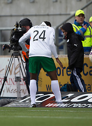 Hibernian's Dominique Malonga puts his foot through the advert. <br /> Falkirk 0 v 3 Hibernian, Scottish Championship game played at The Falkirk Stadium 2/5/2015.