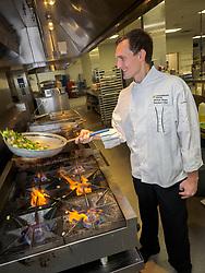 United States, Washington, Bellevue, chef in kitchen