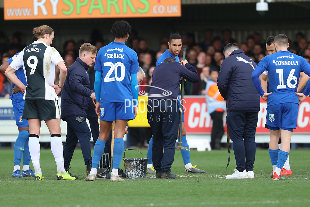 Groundsmenm repairing ground during the EFL Sky Bet League 1 match between AFC Wimbledon and Gillingham at the Cherry Red Records Stadium, Kingston, England on 23 March 2019.