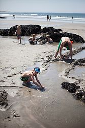 Father with his kids building a sandcastle on the beach, Viana do Castelo, Norte Region, Portugal