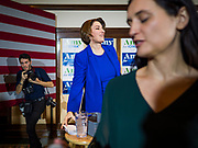 12 JANUARY 2020 - PERRY, IOWA: US Senator AMY KLOBUCHAR (D-MN), center, finishes speaking during a campaign event in the Hotel Pattee in Perry, IA, Sunday. Sen. Klobuchar brought her presidential campaign to Perry, a farming community about 50 miles west of Des Moines. Iowa hosts the first event of the presidential selection process in February. The Iowa Caucuses are Feb. 3, 2020.       PHOTO BY JACK KURTZ