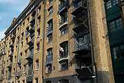 Metropolitan Wharf in Wapping, London, England, United Kingdom. Metropolitan Wharf is an iconic eight storey Grade II Listed Victorian riverside warehouse building, which has been restored to provide office accommodation in<br /> a historical working environment.