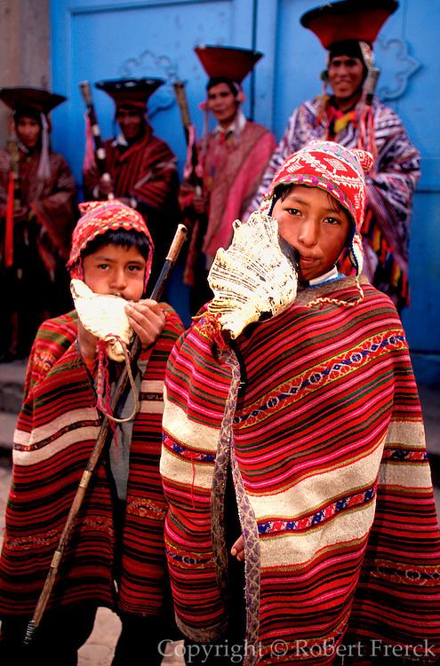PERU, HIGHLANDS, MARKETS Pisac; boys blowing shell horns
