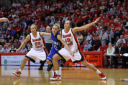 07 February 2009: Kara Mullins struggles to get position on Katie Broadway and Ashleen Bracey. Illinois State increased their 1st place lead by beating 2nd place Indiana State by a score of 69-48. The Illinois State University Redbirds hosted the Indiana State University Sycamores on Doug Collins Court inside Redbird Arena on the campus of Illinois State University in Normal Illinois