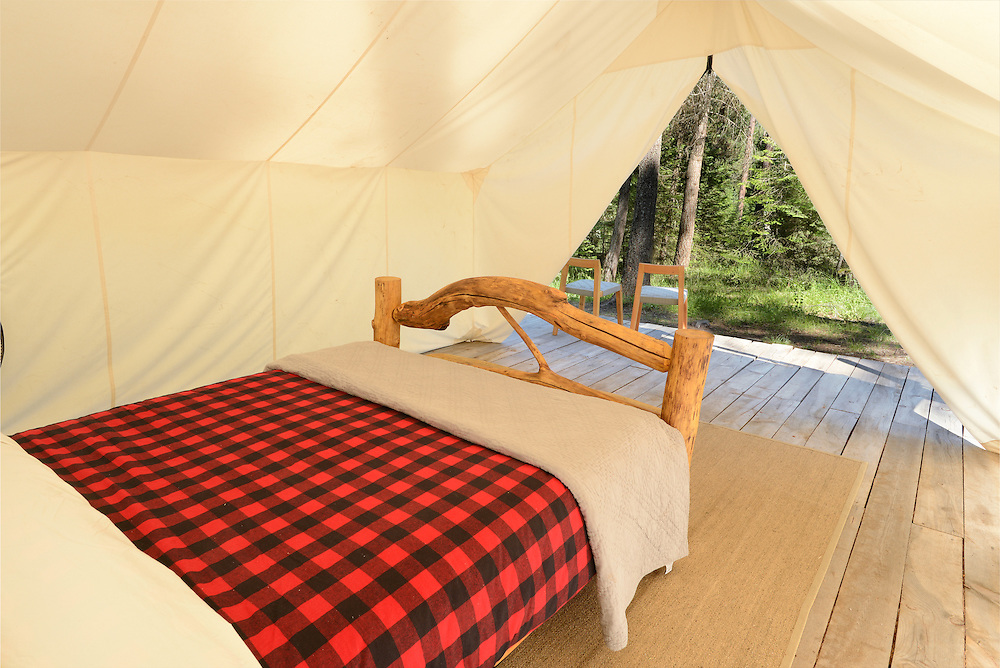 Log bed in a wall tent at the Minam River Lodge in Oregon's Wallowa Mountains.