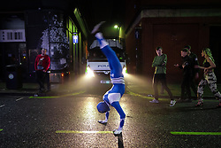 © Licensed to London News Pictures . 27/12/2018. Wigan, UK. A man in fancy dress performs summersaults on King Street . Revellers in Wigan enjoy Boxing Day drinks and clubbing in Wigan Wallgate . In recent years a tradition has been established in which people go out wearing fancy-dress costumes on Boxing Day night . Photo credit: Joel Goodman/LNP
