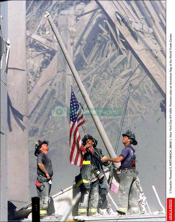 © Franklin Thomas E./KRT/ABACA. 28646-1. New York City-NY-USA. Firemen raise an American flag at the World Trade Center.  | 28646_01