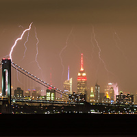 Lightening over New York city with the One World Trade Center building, Empire State Building and Verrazano–Narrows Bridge.
