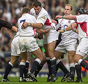Twickenham. Surrey. UK England vs New Zealand, Autumn Internationals.<br /> Martin JOHNSON lifted by left, Richard HILL, right, Lawrence DALLAGLIO. scrum cap Phil VICKERY.<br /> 09/11/2002<br /> International Rugby England vs New Zealand [Mandatory Credit Peter SPURRIER/Intersport Images]
