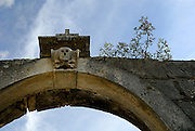 Skull and crossbones on arch above entrance to cemetery, village of Zrnovo, island of Korcula, Croatia