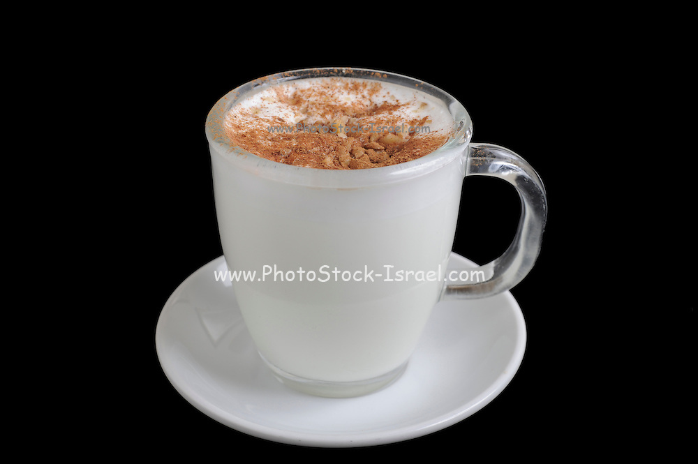 Salep, hot milk or water thickened with a powder made from grinding orchid tubers Originally from Turkey it is popular in the Middle East garnished with cinnamon and ground nuts On Black Background