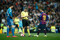 March 2, 2019 - Madrid, MADRID, SPAIN - Undiano Mallenco, referee of the match, and Lionel (Leo) Messi of FC Barcelona protestan in front of Thibaut Courtois of Real Madrid during the spanish league, La Liga, football match played between Real Madrid and FC Barcelona at Santiago Bernabeu Stadium in Madrid, Spain, on March 02, 2019. (Credit Image: © AFP7 via ZUMA Wire)