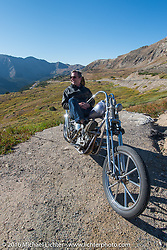 Bill Buckingham with his 1923 Harley-Davidson J model custom chopper (that won top honors at Born Free 6) at the top of Loveland Pass during Stage 10 (278 miles) of the Motorcycle Cannonball Cross-Country Endurance Run, which on this day ran from Golden to Grand Junction, CO., USA. Monday, September 15, 2014.  Photography ©2014 Michael Lichter.