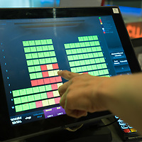 Employee points to a reserved seat on a computer screen at the Cinema City movie theatre reopening during the ease of the COVID-19 restrictions in Budapest, Hungary on July 2, 2020. ATTILA VOLGYI