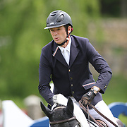 Beat Mandli riding Antares F in action during the $35,000 Grand Prix of North Salem presented by Karina Brez Jewelry during the Old Salem Farm Spring Horse Show, North Salem, New York, USA. 15th May 2015. Photo Tim Clayton