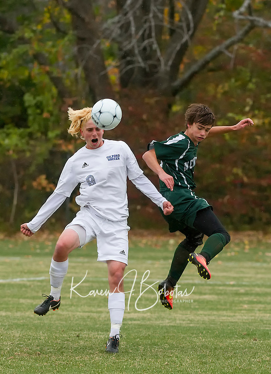 Brendan Lemay and Justin Shokal go for a head ball during second round of tournament play for NHIAA Division III soccer on Thursday afternoon.  (Karen Bobotas/for the Laconia Daily Sun)