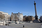 Trafalgar Square, empty. March 24th 2020 was the first day of enforced lockdown in the UK, in order to stop the spread of the Coronavirus Covid 19. On what would normally be a bustling business / week day in London, the city was deserted, with just a few people in masks out on the street, plus a few taxis and mostly empty buses.