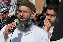© London News Pictures. Anjem Choudary (L) and Siddhartha Dhar (R using camera) at a Muslims Against Crusades demonstration outside the American Embassy in Grosvenor Square on the tenth anniversary of the 9/11 attacks in London on September 11, 2011. There has been speculation that Siddhartha Dhar is this the new 'Jihadi John', who appeared in a recent ISIS video. Photo credit: LNP