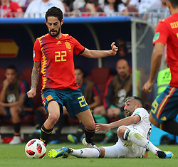 MOSCOW, July 1, 2018  Isco (top) of Spain vies with Alexander Samedov of Russia during the 2018 FIFA World Cup round of 16 match between Spain and Russia in Moscow, Russia, July 1, 2018. (Credit Image: © Yang Lei/Xinhua via ZUMA Wire)