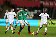 Claudio Yacob of West Bromwich Albion © goes past Jordan Ayew of Swansea city (r). Premier league match, Swansea city v West Bromwich Albion at the Liberty Stadium in Swansea, South Wales on Saturday 9th December 2017.<br /> pic by  Andrew Orchard, Andrew Orchard sports photography.