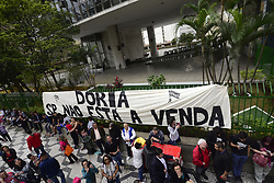 August 1, 2017 - Sao Paulo, Brazil - With the slogan ''São Paulo is not for sale'', protesters linked to leftist parties like PT, PCdoB and PSOL, made a protest in front of the São Paulo City Hall on Tuesday afternoon against the management projects Of the mayor João Doria (PSDB) of concession and privatization..Mayor João Doria has already sent four concession projects to the Chamber, two of which (Pacaembu stadium and concessions package) were approved in the first vote and should be voted on Monday in this semester. Last week, the Chamber held the first series of public hearings on the design of the concessions package that includes the Single Ticket, bus terminals, parks, markets, bicycle sharing, tow truck service and street furniture, such as public toilets. (Credit Image: © Cris Faga/NurPhoto via ZUMA Press)