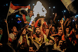 CAIRO, Oct. 9, 2017  Egyptians celebrate after a 2018 FIFA World Cup qualification match between Egypt and Congo, in Cairo, Egypt, on Oct. 8, 2017. Egypt won 2-1 on Sunday and secured its place in the FIFA World Cup finals in Russia. (Credit Image: © Str/Xinhua via ZUMA Wire)