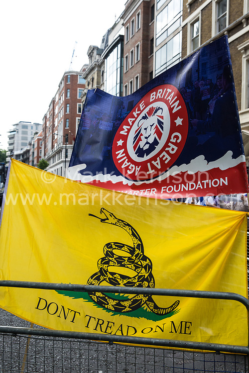 London, UK. 10th June, 2018. Make Britain Great and Gadsden banners displayed by pro-Israel activists staging a counter-protest to the pro-Palestinian Al Quds Day march through central London organised by the Islamic Human Rights Commission. An international event, it began in Iran in 1979. Quds is the Arabic name for Jerusalem.