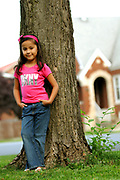 Wednesday, July 22, 2009- Daniela Toledo, 7, is photographed alone and with her parents outside of their Cicero home after a photo of Morales was named a runner-up selection in an Hoy Newspaper reader-submitted kids photo contest. Toledo is joined by her mother and father Llely and Alberto Toledo.