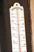 Old thermometer on the wall. Marked with Senegal, New Caldonia, and other strange words. Domaine Marc Kreydenweiss, Andlau, Alsace, France