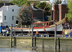 © Licensed to London News Pictures. 19/04/2012. London, UK .The Royal barge Gloriana is  lowered into the River Thames today for the first time. Gloriana was designed to resemble vessels in Canaletto's famous painting of an 18th century river pageant on the Thames Gloriana will be rowed by eighteen oarsmen, including Britain's Olympian Sir Steven Redgrave. It will lead a pageant of more than 1,000 boats will sail down the Thames on June 3 to mark the 60th anniversary of Her Majesty's reign . Photo credit : Stephen Simpson/LNP
