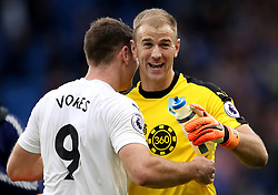 Burnley's Sam Vokes (left) celebrates with Burnley goalkeeper Joe Hart after the final whistle during the Premier League match at the Cardiff City Stadium.