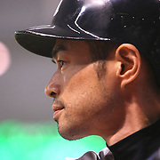 Yankees right fielder Ichiro Suzuki warms up during a major league baseball game between the New York Yankees and the Tampa Bay Rays at Tropicana Field on Thursday, Sept. 17, 2014 in St. Petersburg, Florida. The Yankees won the game 3-2 and this was Jeter's last game against Tampa Bay. (AP Photo/Alex Menendez)