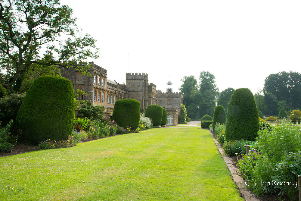 Herbaceous borders and lawn leading to the main house at Forde Abbey, Chard, Dorset, UK
