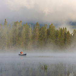 A canoe in early morning on East Inlet in Pittsburg, New Hampshire.  A pond upstream from Second Connecticut Lake.