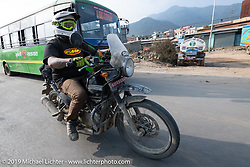 Tattoo artist Justin Big Meas Wilson riding a Royal Enfield Himalayan in Motorcycle Sherpa's Ride to the Heavens motorcycle adventure in the Himalayas of Nepal. Riding from Daman back to Kathmandu. Wednesday, November 13, 2019. Photography ©2019 Michael Lichter.