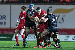 Scarlets' Aaron Shingler is tackled by Ospreys' Justin Tipuric and Dan Lydiate - Mandatory by-line: Craig Thomas/Replay images - 26/12/2017 - RUGBY - Parc y Scarlets - Llanelli, Wales - Scarlets v Ospreys - Guinness Pro 14